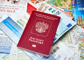 Russian passport and Euro banknotes on the map background