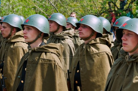 Soviet soldiers in helmets and cloaks