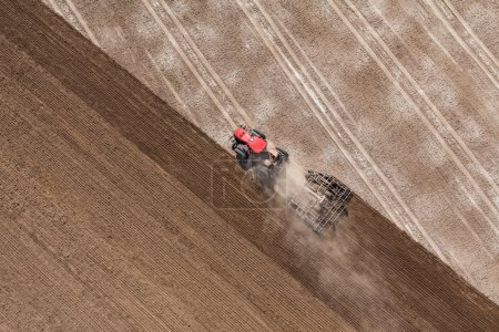 Tractor working on the harvest field