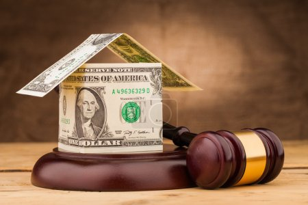 Judge gavel with money house