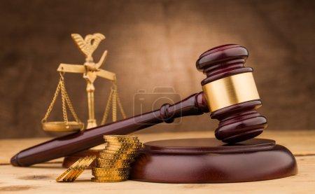 Photo pour Judge gavel with money  and scales closeup - image libre de droit