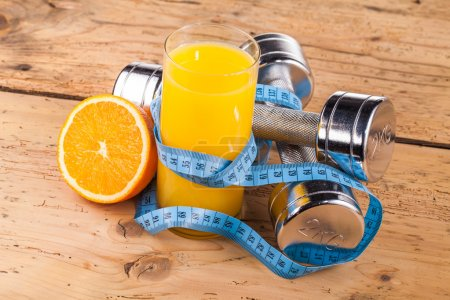 Fitness equipment and healthy orange juice