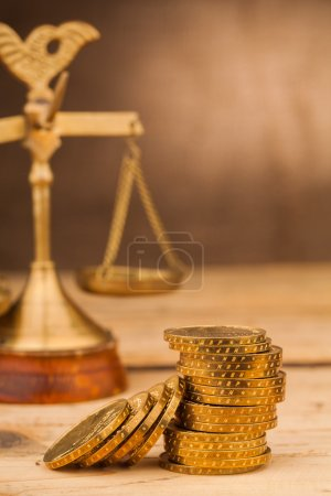Scales and money coins pile on table