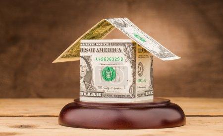 Dollar money house on gavel sound block