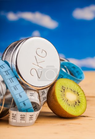 Fitness equipment , weights and kiwi