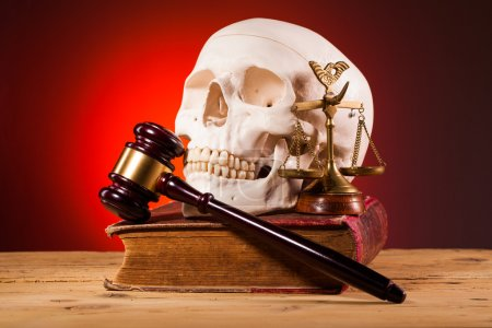 Human scull  scales of justice  gavel and old book
