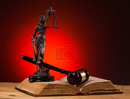 Gavel, lady of justice and old book