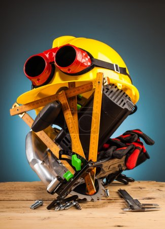 yellow helmet and wood mounting tools