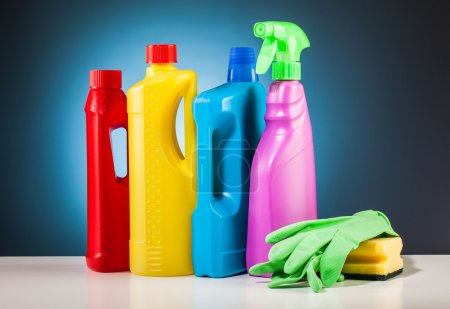 Colorful cleaning equipment and blue background