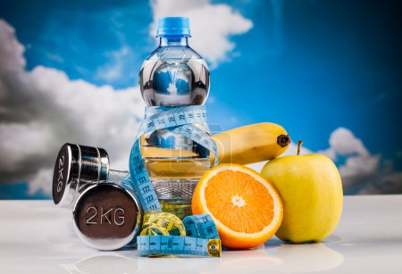 Photo for Fitness water and orange fruit composition - Royalty Free Image