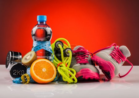 Photo for Water and  fitness equipment  composition - Royalty Free Image