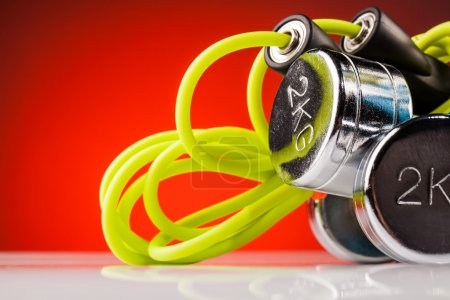 Fitness jump rope  and steel dumbbells