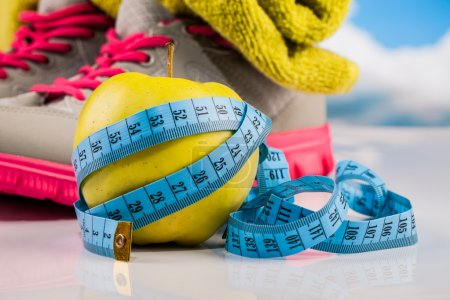 Fitness measure tape and healthy food