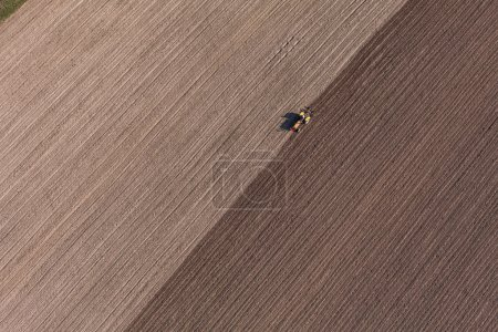 Harvest fields with tractor