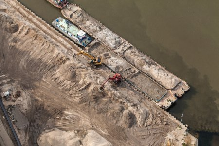 Aerial view of long arm excavator working