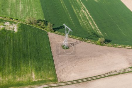 Aerial image of harvest fields and electrical wires with large s