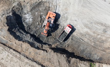 Aerial view of the earth mover in the quarry