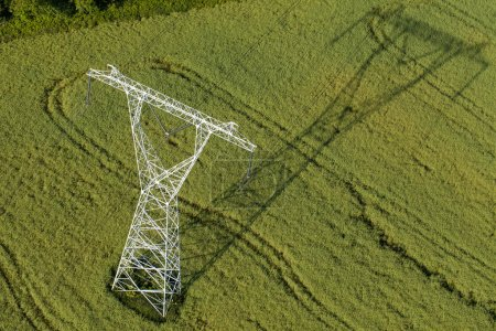 Aerial view of electrical wires in fields