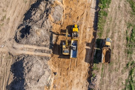 Excavator working on field