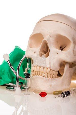 Medicines, human skull and stethoscope
