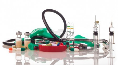 Medicines, rubber gloves and stethoscope