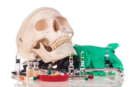 Medicines, human skull and stethoscope