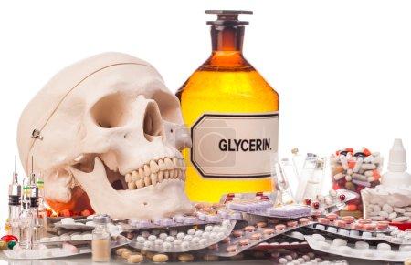 Medicines, syringes and human skull