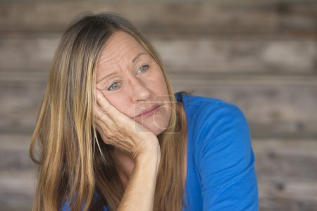 Photo for Portrait attractive mature woman with bored, stressed, lonely, depressed and sleepy facial expression, blurred background, copy space. - Royalty Free Image