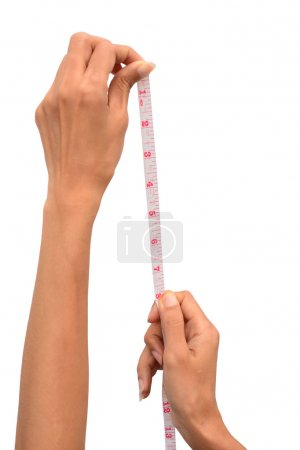 Woman hands with measure tape