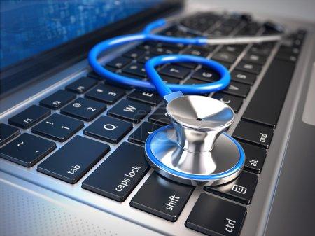 Photo for Blue stethoscope on laptop keyboard - Royalty Free Image