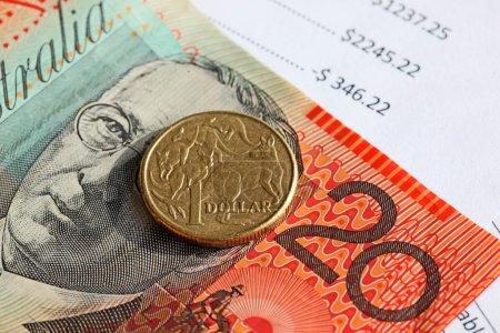 Australian twenty dollar note with one dollar coin...