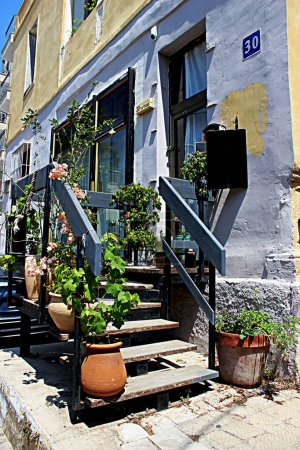 Stairs to the apartment with potted flowers. Entrance to the house from the street in Tel Aviv.