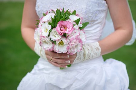 Wedding Flowers Roses Bouquet in Bride Hands