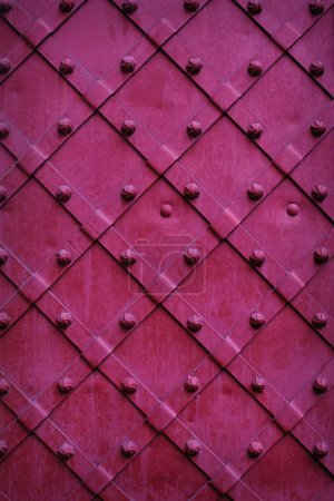 Texture chipped metals doors dark red color