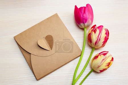 Photo for Tulips and boxes with gifts on a white background. - Royalty Free Image