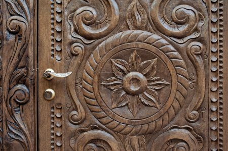 beautiful ornately carved wooden panel in an antique door