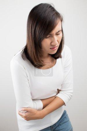 Woman heaving belly ache
