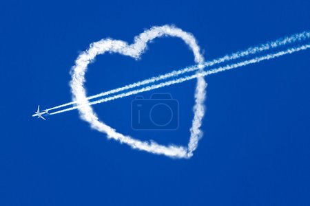 aircraft at the blue sky flying through the heart of the clouds