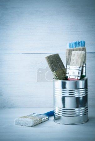 paint bucket and paintbrush  on wood