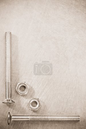 Bolts at metal background