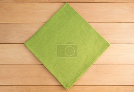 Photo for Green cloth napkin on wooden background - Royalty Free Image