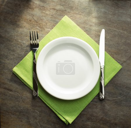 plate, knife and fork on napkin