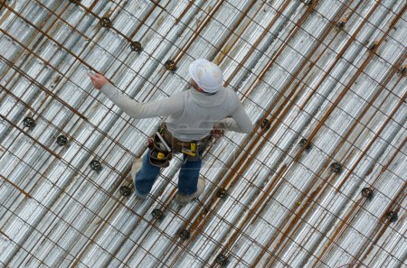 Roofer construction worker in a construction site