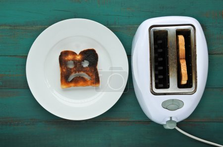 Flat lay view of one slices of burnt toast