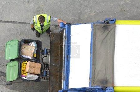Garbage man loading garbage truck