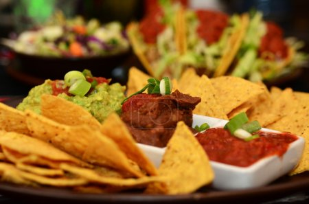 Photo for Nachos. A traditional Mexican dish served on plate in Mexican restaurant in Mexico. - Royalty Free Image
