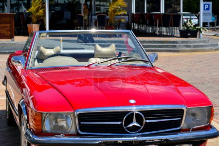 Red Mercedes Benz 560SL