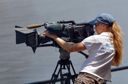 Photo for GOLD COAST, AUS - NOV 06 2014:Camerawoman filming. In 2006, there were approximately 27,000 television, video, and motion picture camera operators employed in the United States. - Royalty Free Image