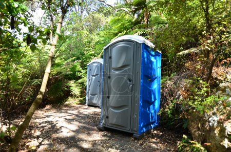 Photo for Portable blue plastic Toilets in forest - Royalty Free Image