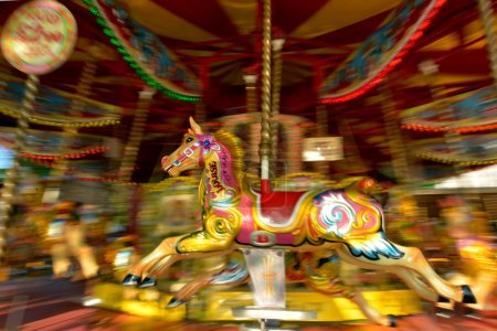 Motion blurr of vintage horse of amusement ride on merry-go-roun